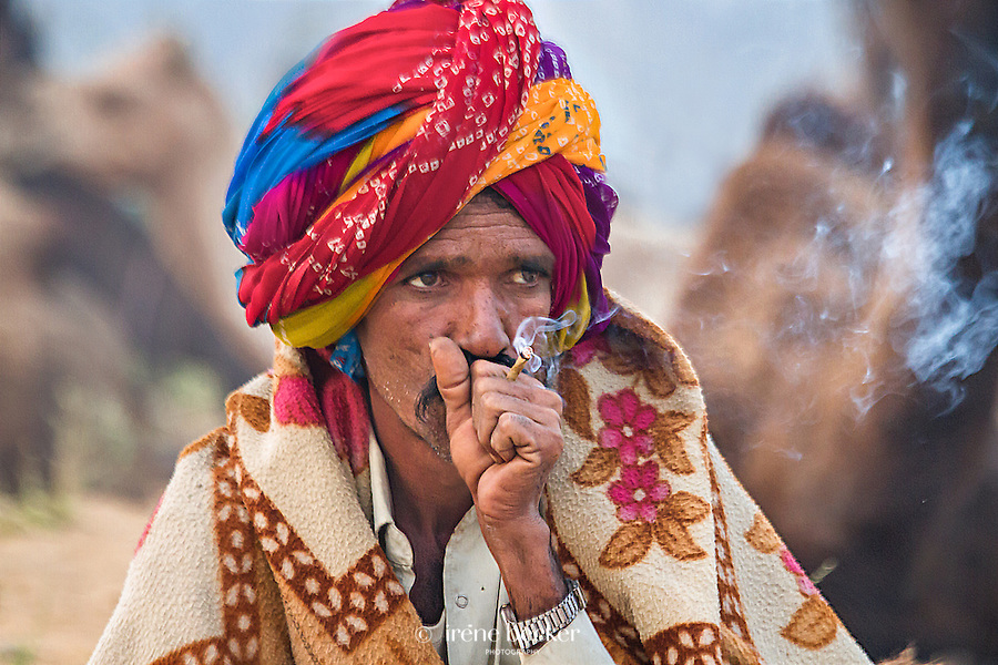 Smoking Man. Camel vendor at the Pushkar Fair, Rajasthan, India.