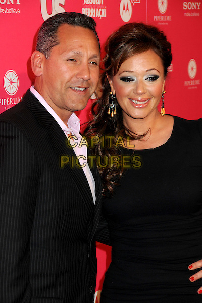 ANGELO PAGAN & LEAH REMINI.US Weekly Hot Hollywood Style Issue Event held at Drai's at the W Hollywood Hotel, Hollywood, California, USA..April 22nd, 2010.half length black dress dangling earrings  husband wife married suit .CAP/ADM/BP.©Byron Purvis/AdMedia/Capital Pictures.