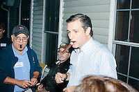 "Texas senator and Republican presidential candidate Ted Cruz smokes a cigar after speaking at an event called ""Smoke a cigar with Ted Cruz"" at a house party at the home of Linda & Steven Goddu Salem, New Hampshire."