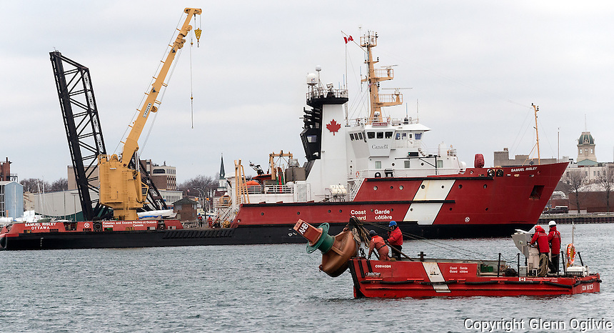 Crews aboard the Canadian Coast Guard Ship Samuel Risley are busy removing navigational bouys for winter service and repairs. Recently Sarnia Harbour has been dredged to allow larger ships into the port for winter repairs and layovers.