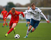 16th November 2019; Leckwith Stadium, Cardiff, Glamorgan, Wales; European Championship Under 19 2020 Qualifiers, Russia under 19s versus Wales under 19s; Sam Pearson of Wales Under 19 and Ilya Agapov of Russia Under 19 challenge for the ball - Editorial Use