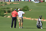 Graeme McDowell consults with his caddy before playing his 2nd shot on the 18th hole during Day 2 of the Dubai World Championship, Earth Course, Jumeirah Golf Estates, Dubai, 26th November 2010..(Picture Eoin Clarke/www.golffile.ie)