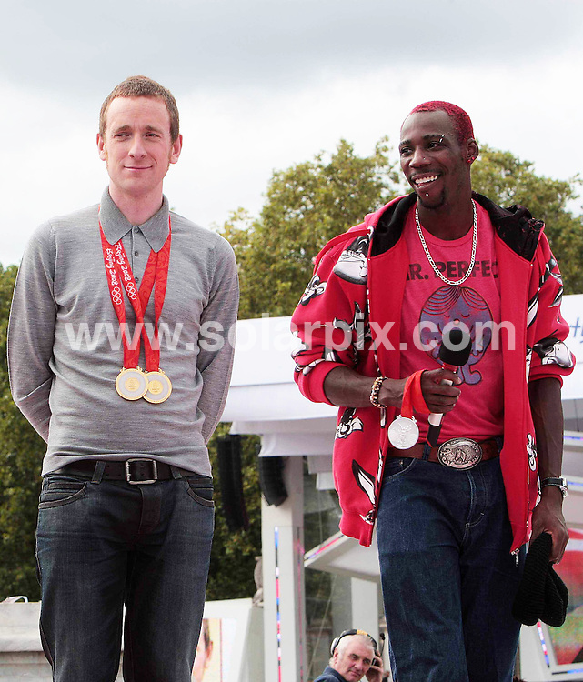 **ALL ROUND PICTURES FROM SOLARPIX.COM**.**NO UK NEWSPAPER PUBLICATION **UK MAGAZINE & SUPPLEMENT PUBLICATION ONLY** AND NO PUBLICATION IN FRANCE, SCANDINAVIA, AUSTRALIA AND GERMANY** .The official hand over for  the 2012 Olympic games took place by Buckingham Palace in central London..This pic:Bradley Wiggins,Phillips Idowu..JOB REF:7113-SFE       DATE:24_08_08 .**MUST CREDIT SOLARPIX.COM OR DOUBLE FEE WILL BE CHARGED* *UNDER NO CIRCUMSTANCES IS THIS IMAGE TO BE REPRODUCED FOR ANY ONLINE EDITION WITHOUT PRIOR PERMISSION*