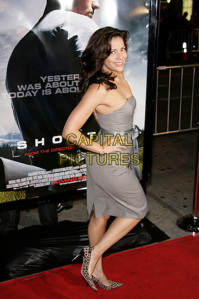 "CONSTANCE MARIE.At the ""Shooter"" Los Angeles Premiere held at Mann Village Theatre, Westwood, California, USA, 08 March 2007..full length strapless grey dress leg hand on hip over shoulder leopard print shoes.CAP/ADM/ZL.©Zach Lipp/AdMedia/Capital Pictures."