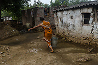A woman carries a bucket of water in village Gorikothapally, Telangana, Indiia, on Friday, February 8, 2019. Photographer: Suzanne Lee for Safe Water Network