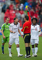 25 April 2010: Toronto FC midfielder Martin Saric #25 receives a yellow card during a game between the Seattle Sounders and Toronto FC at BMO Field in Toronto..Toronto FC won 2-0....