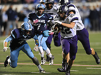 NWA Democrat-Gazette/ANDY SHUPE<br /> Luke Rapert (22) of Fayetteville carries the ball ahead of Brady Patrick of Har-Ber Saturday, Dec. 5, 2015, during the first half of the Class 7A state championship game at War Memorial Stadium in Little Rock. Visit nwadg.com/photos to see more photographs from the game.