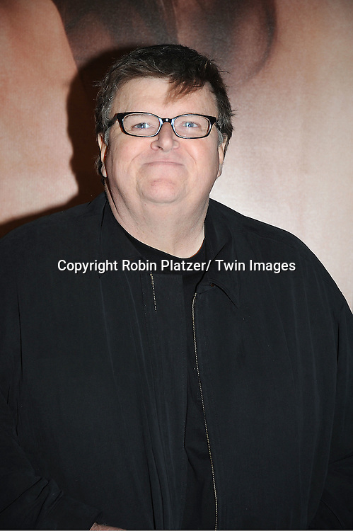 "director Michael Moore arrives to The World Premiere of "" The Five-Year Engagement"" at the opening night of The Tribeca Film Festival at the Ziegfeld Theatre in New York City on ..April 18, 2012."