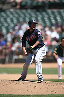 OAKLAND, CA - JUNE 30:  George Kontos #70 of the Cleveland Indians pitches against the Oakland Athletics during the game at the Oakland Coliseum on Saturday, June 30, 2018 in Oakland, California. (Photo by Brad Mangin)