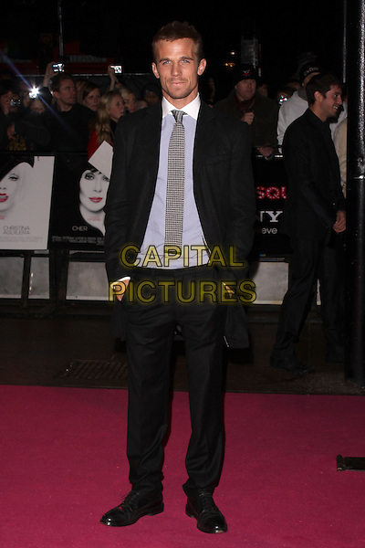 CAM  GIGANDET.'Burlesque' UK Gala premiere at the Empire Cinema, Leicester Square, London, England, UK,.13th December 2010..full length grey gray coat blue shirt white collar tie hands in pockets .CAP/AH.©Adam Houghton/Capital Pictures.