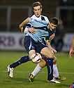 Forfar's Chris Templeman holds off Ayr Utd's Anthony Marenghi.