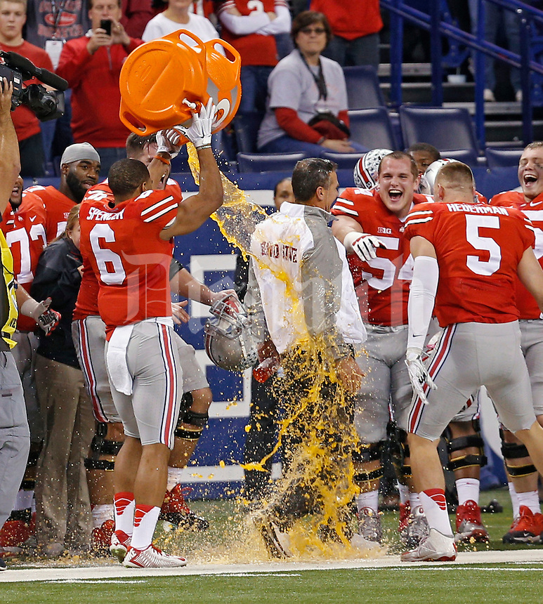 Ohio State Buckeyes head coach Urban Meyer receives the Gatorade bath after beating Wisconsin Badgers 59-0 in the 2014 Big Ten Football Championship Game at Lucas Oil Stadium in Indianapolis, Ind. on December 6, 2014.  (Dispatch photo by Kyle Robertson)