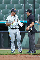 West Virginia Power manager Wyatt Toregas (51) argues a call with home plate umpire Kelvis Velez during the game against the Kannapolis Intimidators at Kannapolis Intimidators Stadium on July 25, 2018 in Kannapolis, North Carolina. The Intimidators defeated the Power 6-2 in 8 innings in game one of a double-header. (Brian Westerholt/Four Seam Images)