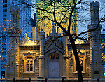 Chicago, IL<br /> The Old Chicago Watertower (1869)  landmark on North Michiga Avenue with lights at dusk