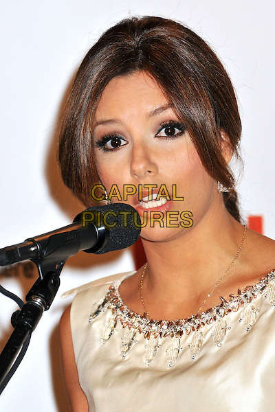 EVA LONGORIA PARKER.2009 ALMA Awards Press Conference held at Beso, Hollywood, CA, .25th August 2009..portrait headshot gold cream beaded embellished beaded tanned necklace neckline microphone speaking talking funny lips mouth.CAP/ADM/BP.©Byron Purvis/AdMedia/Capital Pictures.