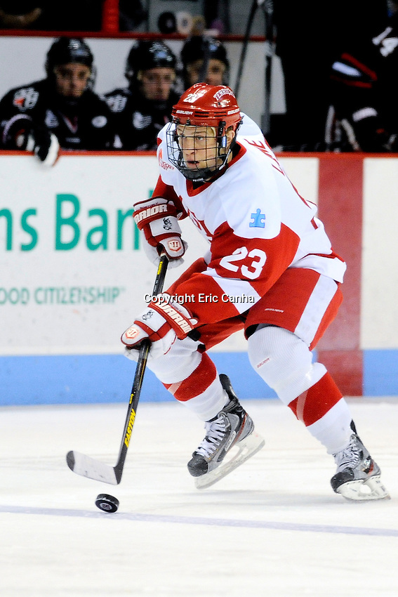 Boston University Terriers forward Matt Lane (23) works the puck during the third period of the Northeastern University at Boston University NCAA hockey match held at the Agganis Arena in Boston Massachusetts. Final score Northeastern University 6 Boston University 5  Eric Canha/CSM