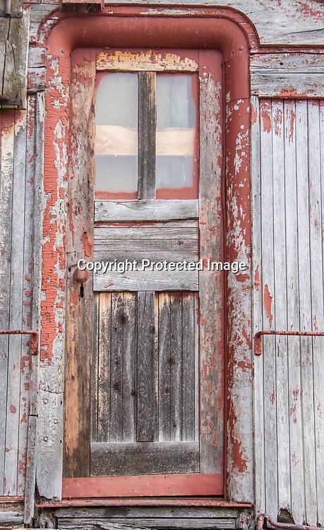 A door still hangs on an antique train.