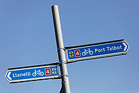 A Llanelli and Port Talbot cycle track signs at the seafornt, Swansea, Wales, UK. Thursday 26 March 2020