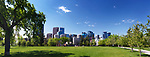 Panoramic scenery of Calgary city downtown skyline  and Sunnyside Bank Park on a sunny summer day. Calgary, Alberta, Canada 2017.
