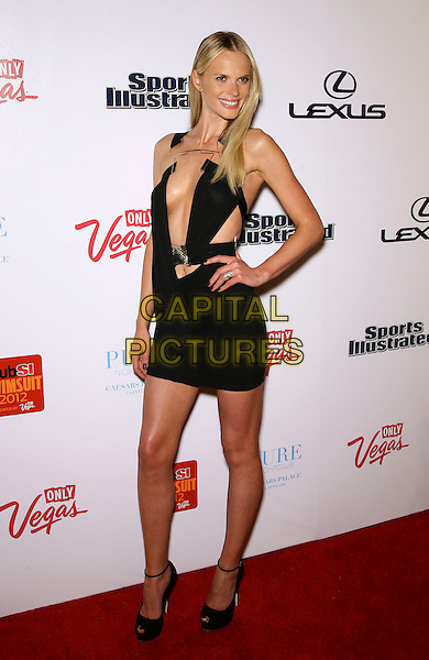 Anne V (Anne Vyalitsyna).Club SI Swimsuit at Pure Nightclub in Caesars Palace Las Vegas. .February 16th, 2012.sports illustrated full length black dress plunging neckline cleavage hand on hip.CAP/ADM/MJT.© MJT/AdMedia/Capital Pictures.