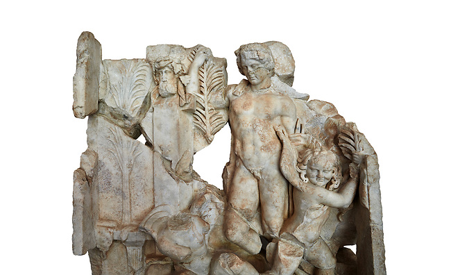 Close up of a Roman Sebasteion relief  sculpture of Agon Aphrodisias Museum, Aphrodisias, Turkey.     Against a white background.<br /> <br /> The scene is an allegory of the athletic contest (or agon). The pillar was a beareded head of Hermes the god of the Gymnasium. Nearby is a palm of victory and a prize table with victory ribbon on it. Two winged baby Eros figures are struggling over a palm branch ( mostly broken): they act out the idea of contest, which is personified in the youthful figure behind. He hold another palm of victory: he is Agon himself.
