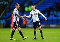 Bolton Wanderers' David Wheater and Josh Vela shake hands after the 1-1 draw against Fulham.<br /> <br /> Photographer Leila Coker/CameraSport<br /> <br /> The EFL Sky Bet Championship - Bolton Wanderers v Fulham - Saturday 10th February 2018 - Macron Stadium - Bolton<br /> <br /> World Copyright &copy; 2018 CameraSport. All rights reserved. 43 Linden Ave. Countesthorpe. Leicester. England. LE8 5PG - Tel: +44 (0) 116 277 4147 - admin@camerasport.com - www.camerasport.com