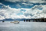 USA, Alaska, Homer, China Poot Bay, Kachemak Bay, a boat heading out of the marina at Homer Spit