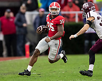 ATHENS, GA - NOVEMBER 23: Brian Herrien #35 of the Georgia Bulldogs runs with the ball as Chris Russell #24 of the Texas A