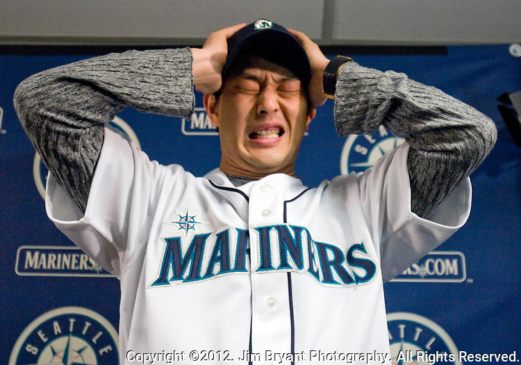 Seattle Mariners' right hand pitcher, Hasashi Iwakuma, a free agent from Japan who signed earlier this winter,makes a face while adjusting his hat at the Seattle Mariners Fan Fest at SAFECO Field in Seattle on January 29, 2012. Jim Bryant Photo. ©2012 All Rights Reserved.