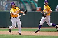 LSU Tigers third baseman Christian Ibarra (14) makes a throw to second base against the Texas A&M Aggies in the NCAA Southeastern Conference baseball game on May 11, 2013 at Blue Bell Park in College Station, Texas. LSU defeated Texas A&M 2-1 in extra innings to capture the SEC West Championship. (Andrew Woolley/Four Seam Images).