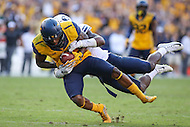 Landover, MD - September 23, 2016: West Virginia Mountaineers wide receiver Shelton Gibson (1) gets tackled after catching a pass during game between BYU and WVA at  FedEx Field in Landover, MD.  (Photo by Elliott Brown/Media Images International)