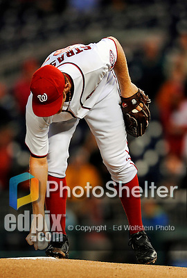 6 September 2011: Washington Nationals pitcher Stephen Strasburg picks up the game ball on the mound prior to starting against the Los Angeles Dodgers at Nationals Park in Washington, District of Columbia. Strasburg struck out 4, and gave up 2 hits in 5 scoreless innings during his first Major League start since having Tommy John surgery last season. The Dodgers defeated the Nationals 7-3 to take the second game of their 4-game series. Mandatory Credit: Ed Wolfstein Photo