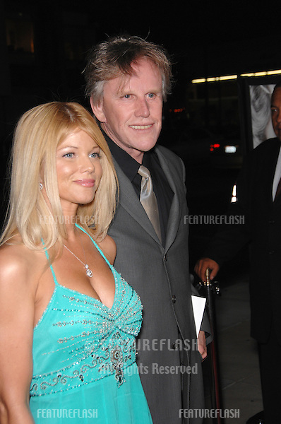 "Actor GARY BUSEY & date at the Los Angeles premiere of ""The Queen""..October 3, 2006  Los Angeles, CA.Picture: Paul Smith / Featureflash"