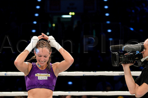 14.12.2-13. Bayreuth, Germany.  German kickboxer Christine Theiss celebrates after her victory over Olga Stavrova from Russia at Oberfrankenhalle in Bayreuth, Germany, 14 December 2013. Theiss won on points and regained and now retires from the sport as world champion.