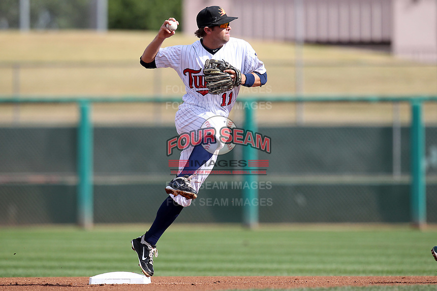 Mesa Solar Sox second baseman Brian Dozier #11 turns a double play during an Arizona Fall League game against the Phoenix Desert Dogs at HoHoKam Park on November 3, 2011 in Mesa, Arizona.  Mesa defeated Phoenix 8-7.  (Mike Janes/Four Seam Images)