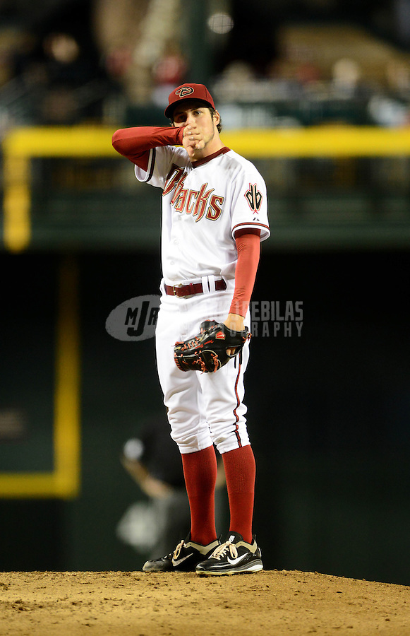 Jul. 3, 2012; Phoenix, AZ, USA: Arizona Diamondbacks pitcher Trevor Bauer reacts after giving up a home run in the second inning against the San Diego Padres at Chase Field. Mandatory Credit: Mark J. Rebilas-