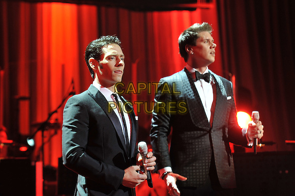 Il Divo performing live in concert at the Royal Albert Hall, Kensington, London, England..17th April 2012.on stage gig performance half length black grey gray suit jacket profile .CAP/MAR.© Martin Harris/Capital Pictures.