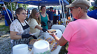NWA Democrat-Gazette/FLIP PUTTHOFF <br /> The townspeople of LaGrange, Mo. serve paddlers Aug. 2 2018 a fundraiser lunch to buy an equipment trailer for the town's Boy Scout troop. Many meals on the Great River Rumble are provided by churches, civic groups and volunteer fire departments along the river to raise money for their towns.