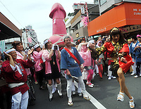 A huge pink penis is carried through the streets of Kawasaki at the Kanamara Matsuri (Festival of the Steel Phallus) 05 April 2009.   The shinto festival dating back to the edo period350 years ago, has it's roots where prostitutes prayed not only that business would be brisk, but for protection from syphilis.  With the spread of syphilis now curbed, participants in the modern festival solicit donations for HIV/AIDS research.