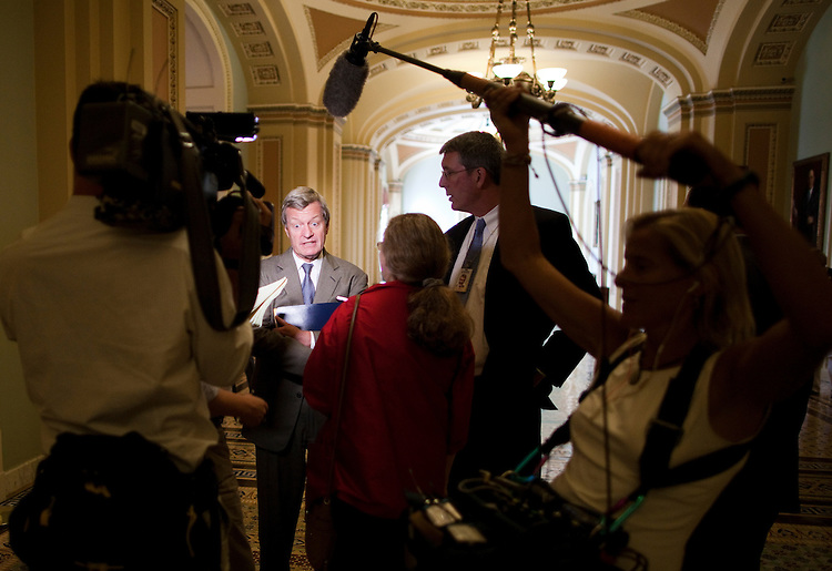 UNITED STATES - JULY 27: Sen. Max Baucus, D-Mont., answers reporters questions in the Ohio Clock Corridor on the second floor of the Capitol on Wednesday, July 27, 2011. (Photo By Bill Clark/Roll Call)