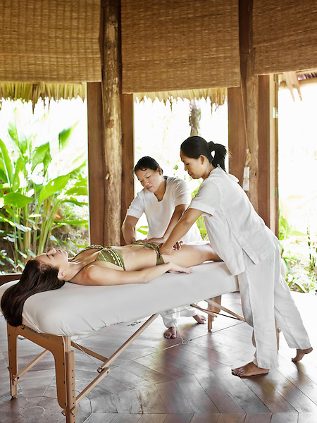 A woman receives a four-handed massage in Treatment Room 4 at Six Senses Spa. This massage is part of Six Senses Sensory Journey treatment. Six Senses Hideaway Yao Noi, Koh Yao Noi, Thailand.