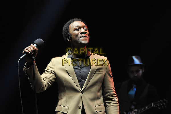 Aloe Blacc.performing live in concert, Hammersmith Apollo, London, England, UK,.15th December 2011..music concert gig live on stage half length microphone black shirt  beige jacket blazer .CAP/MAR.© Martin Harris/Capital Pictures.
