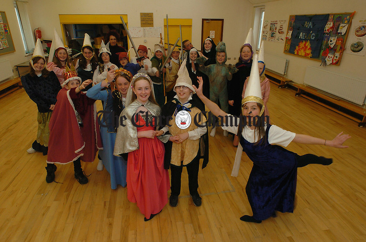 "Pupils from Rang 6 Gaelscoil Mhíchíl Cíosóg, Inis, in a  scene from the All-Ireland winning production of ""Iníon a Ruaigeadh"" with their Class Teacher, Carmel Ní Bheacháín. Photograph by John Kelly."