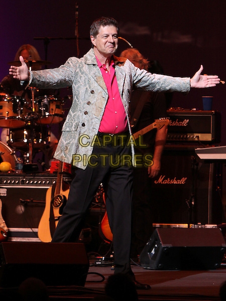 CARL GIAMMARESE of The Buckinghams .Performing at the 25th Anniversary Happy Together Tour at the Cobb Energy Center, Atlanta, GA, USA, .July 28th, 2010..full length live on stage  music concert gig red shirt arms outstretched jacket .CAP/ADM/DH.©Dan Harr/AdMedia/Capital Pictures.