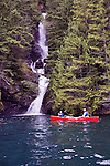 Teddy Thorson (bow) and Eric Thorson (stern) paddle Wenonah Escape on Ross Lake.  Skymo Creek Falls.  Ross Lake National Recreation Area.