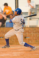 Diego Cruz #34 of the Burlington Royals follows through on his swing versus the Johnson City Cardinals at Howard Johnson Stadium June 27, 2009 in Johnson City, Tennessee. (Photo by Brian Westerholt / Four Seam Images)