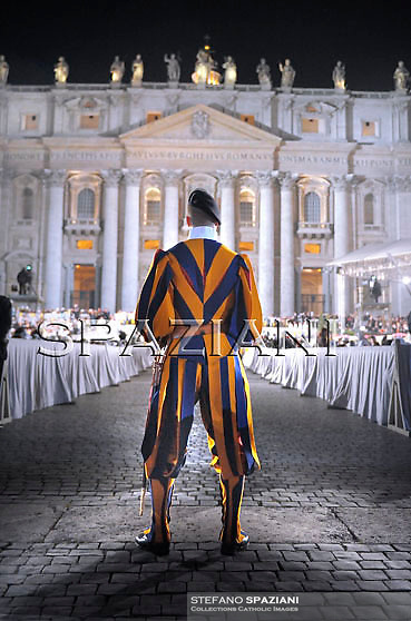 The Corps of the Pontifical Swiss Guard,Pope Benedict XVI addresses some 70,000 youths of dioceses of Rome and Lazio in Saint Peter's square, at the Vatican, late 25 March 2010, during an event to mark the 25th anniversary of the first Youth World Day.