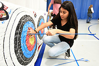 NWA Democrat-Gazette/FLIP PUTTHOFF <br /> ON TARGET<br /> Cynthia Aguilar pulls her arrows from the target Wednesday March 15 2017 during archery competition in Deb Walter's physical education class at Rogers New Tech High School. Students took part in a bull's eye contest on Wednesday. They play archery tic-tac-toe and other games, while shooting arrows from various distances.