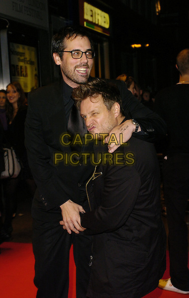 "CHRIS COTTAM (director) & RANKIN.Attends ""The Lives Of The Saints"" UK Film Premiere, held at the Odeon West End Cinema, London, England, October 20th 2006..half length photographer funny pose hand touching crotch holding hands hugging black.Ref: CAN.www.capitalpictures.com.sales@capitalpictures.com.©Can Nguyen/Capital Pictures"