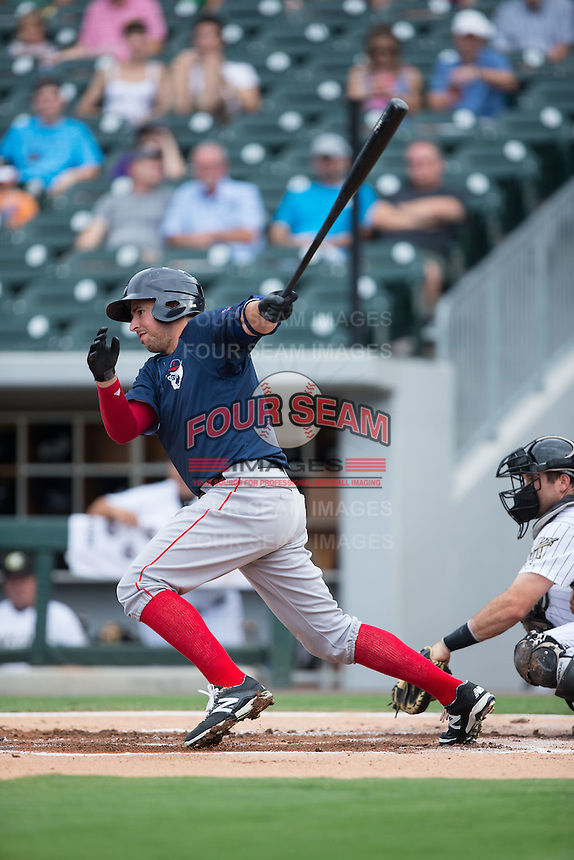 Chris Marrero (21) of the Pawtucket Red Sox follows through on his swing against the Charlotte Knights at BB&T BallPark on July 6, 2016 in Charlotte, North Carolina.  The Knights defeated the Red Sox 8-6.  (Brian Westerholt/Four Seam Images)